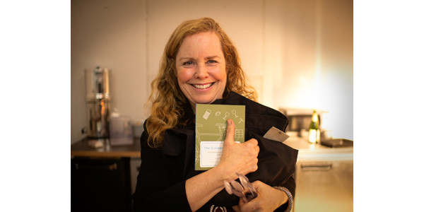 Avril Greenberg raffle winner of Culinary Cyclist at BikeBANQUET to benefit Recycle-A-Bicycle, with special guest Randy Cohen at Nomad Cycle, November 7, 2015